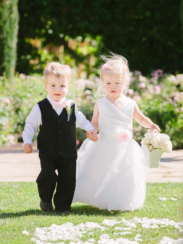 Bernardus Lodge Carmel Wedding. Ringbearer and flowergirl walk down the aisle at a wedding ceremony.
