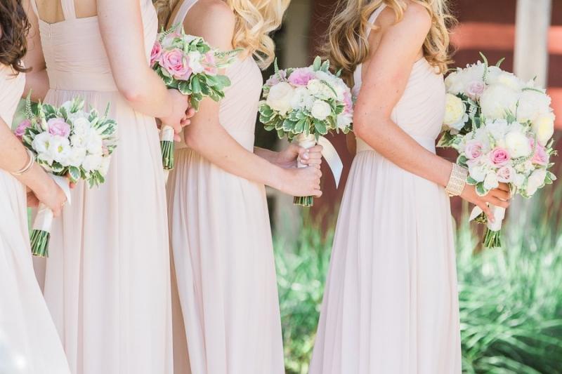 Bernardus Lodge Carmel Wedding. close up photo of bridesmaids holding their pink bouquets
