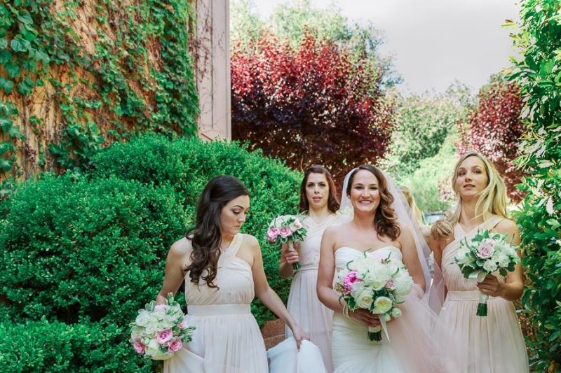 Bernardus Lodge Carmel Wedding. Bride and bridesmaids walking to the wedding ceremony.