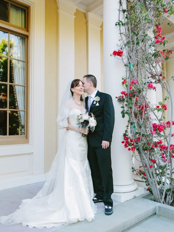 Burlingame Country Club Wedding in Hillsborough. Groom kisses his bride on her cheek.