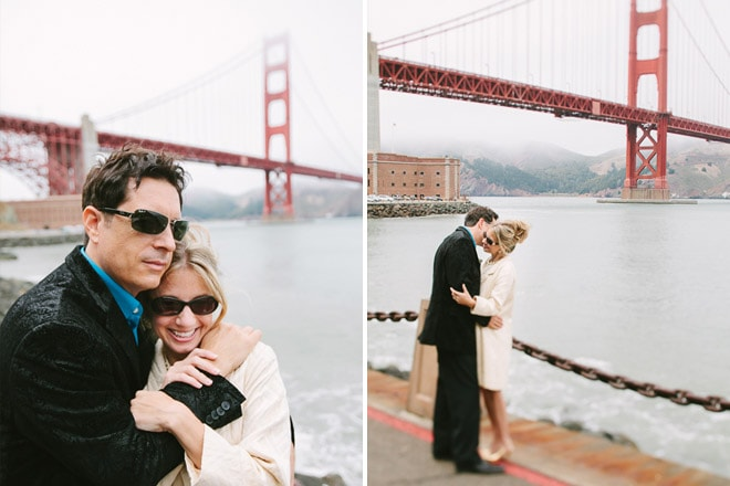 Wedding photographer San Francisco. Groom holding his bride while standing in front of the Golden Gate Bridge