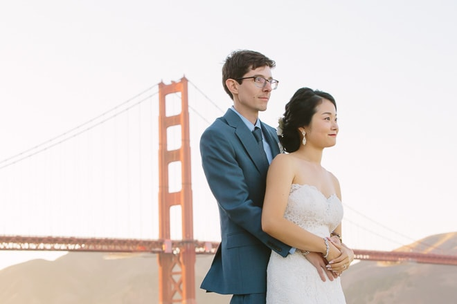 San Francisco Golden Gate Bridge wedding. Groom hugging his bride.