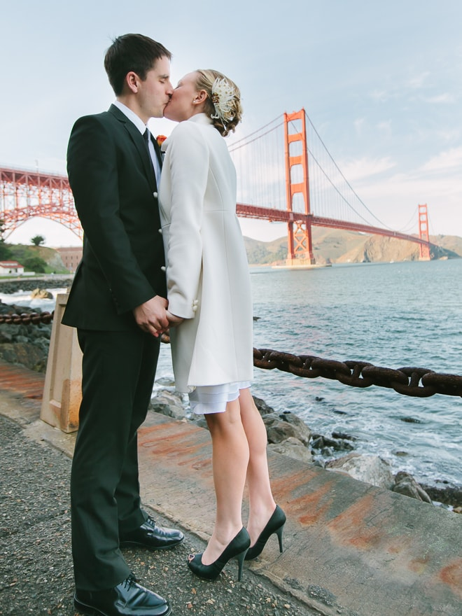 Bride and groom kissing in front of the Golden Gate Bridge. San Francisco wedding photographer, Lilia Photography