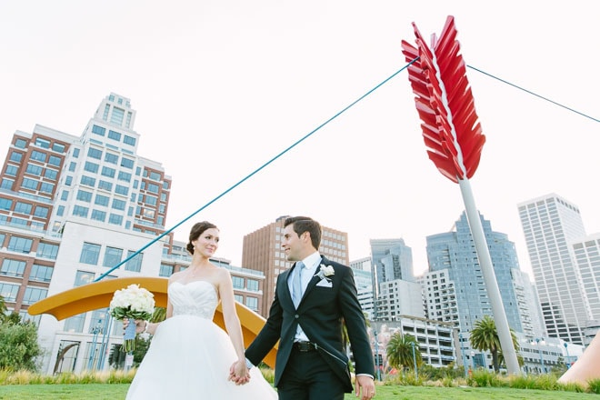 Embarcadero San Francisco Wedding. Best Photo Locations in San Francisco. Bride and groom walking in front of Cupids Span.