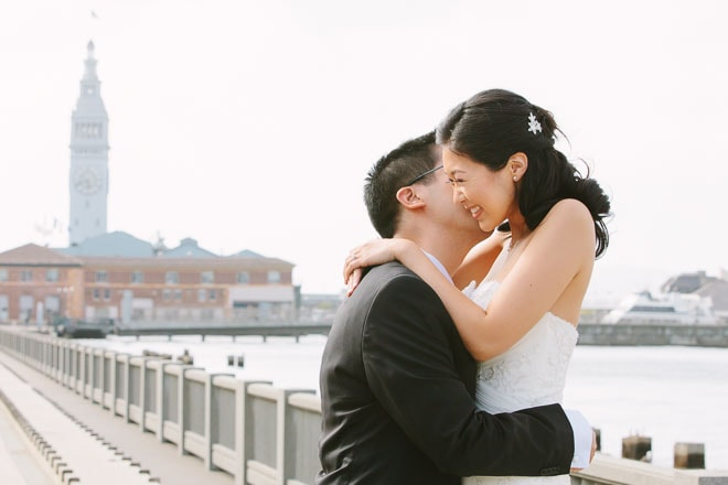 Bride and groom embrace on the Embarcadero in San Francisco