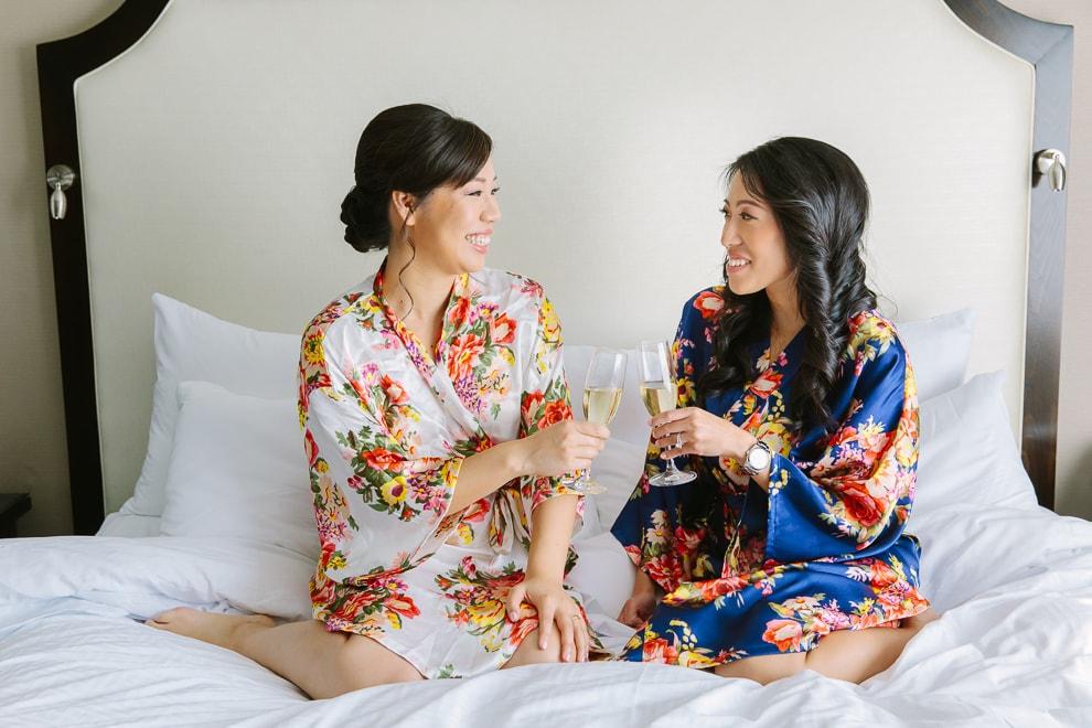 Bride and bridesmaid getting ready at the Fairmont Hotel San Francisco