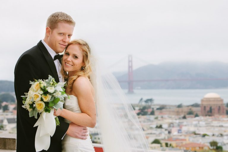 Bride and groom hugging each other at their Flood Mansion San Francisco wedding.