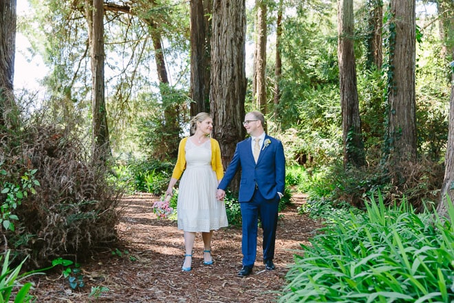 Golden Gate Park wedding. Bride and groom walking near redwood trees in San Francisco.
