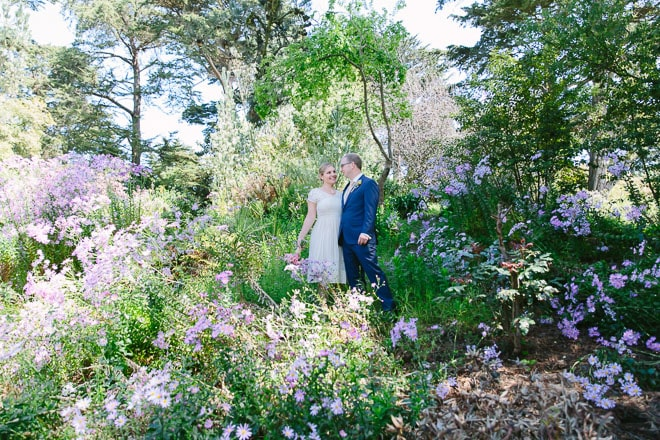 Golden Gate Park wedding. Bride and groom surrounded by flowers at the Botanical Garden.
