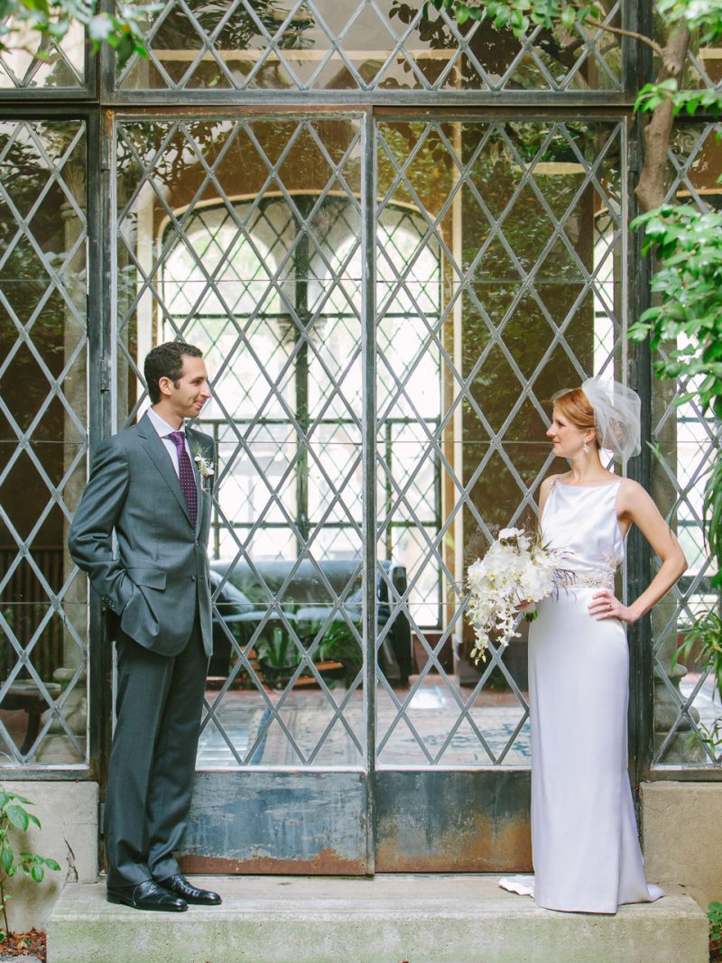 Bride and Groom standing in front of a doorway at their wedding at Berkeley City Club