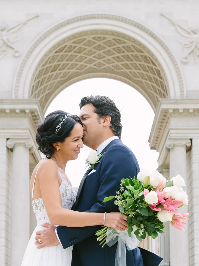 Bride and groom hugging in front of the Legion of Honor museum San Francisco wedding