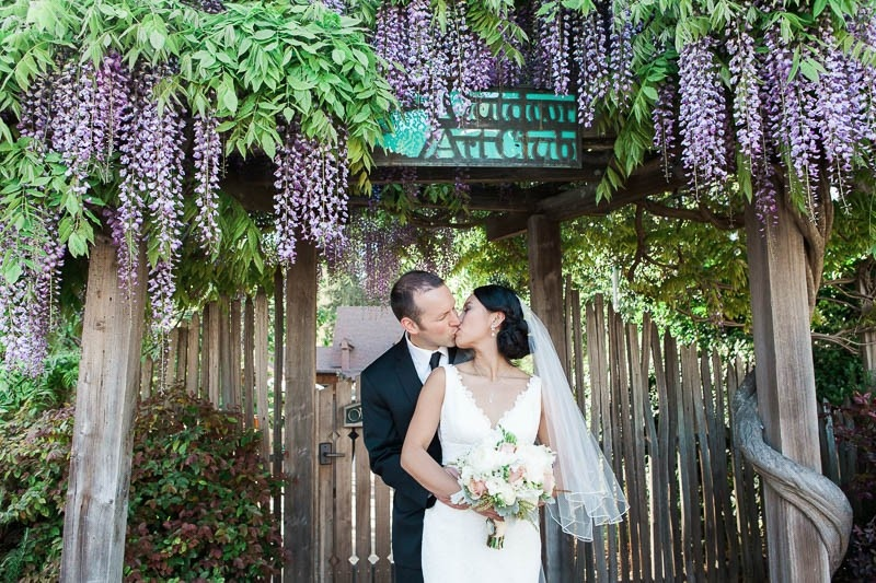 Bride and groom share a kiss at their Outdoor Art Club wedding in Mill Valley.