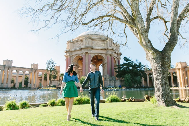 Palace of Fine Arts engagement session. Man and woman holding hands and walking in front of the dome.