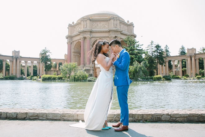 Palace of Fine Arts wedding. Two brides stand together in front of the dome.