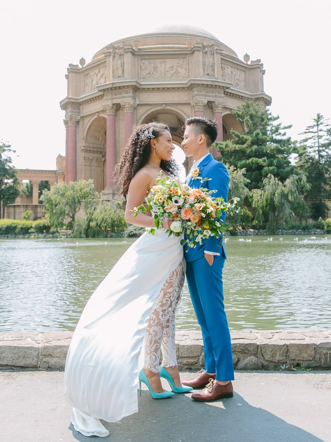 Couple standing in front of the Palace of Fine Arts in San Francisco