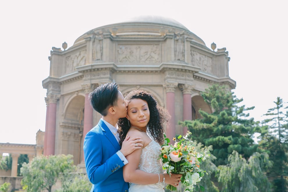 Couple embracing in front of the Palace of Fine Arts in San Francisco