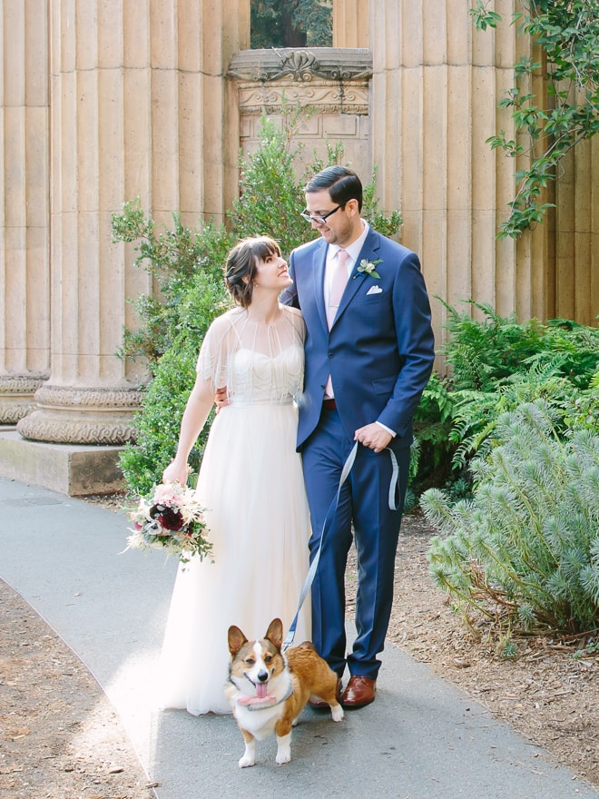 Bride and groom walking with their dog at the Palace of Fine Arts in San Francisco