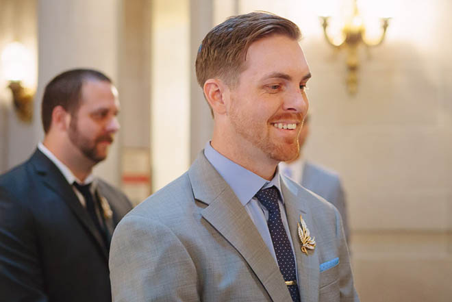 Groom smiling during his wedding ceremony