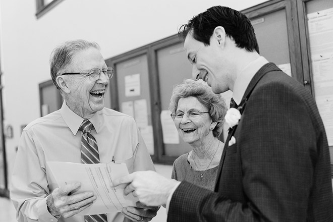 Groom laughing with the Grandparents of the Bride