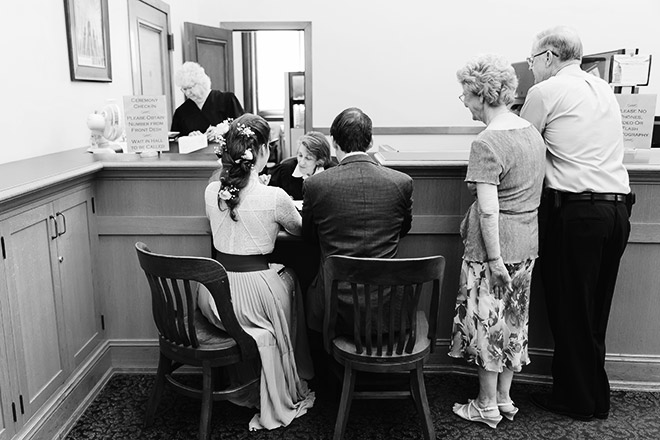 Bride and groom with their witnesses inside the County Clerk's Office