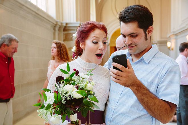 Brother shares a smartphone photo with his sister after her wedding ceremony