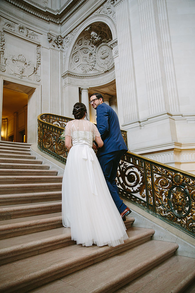 bride and groom walking up the Grand Staircase