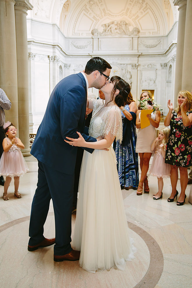 Bride and groom kiss during their ceremony in the Rotunda
