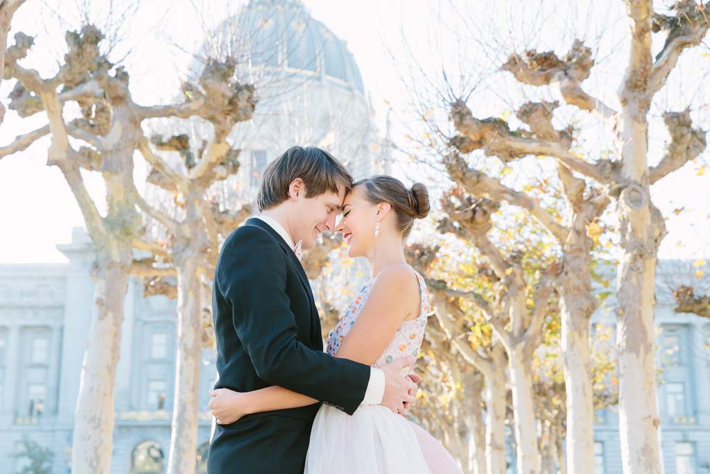 San Francisco City Hall Wedding couple standing underneath the sycamore trees