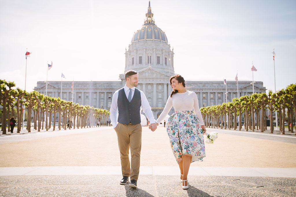 Couple walking in front of San Francisco City Hall