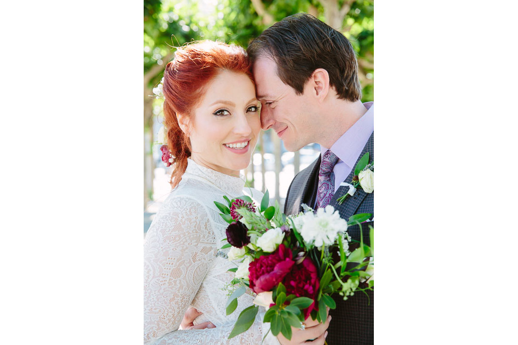 Red haired bride with groom at their San Francisco City Hall wedding