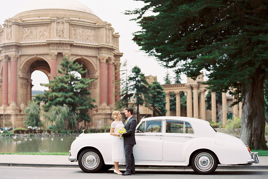 Bride and groom with Rolls Royce in front of the Palace of Fine Arts