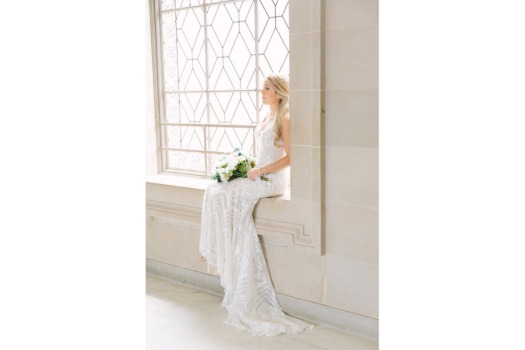 San Francisco City Hall Wedding Photographer. Bride sitting in window. white bridal bouquet