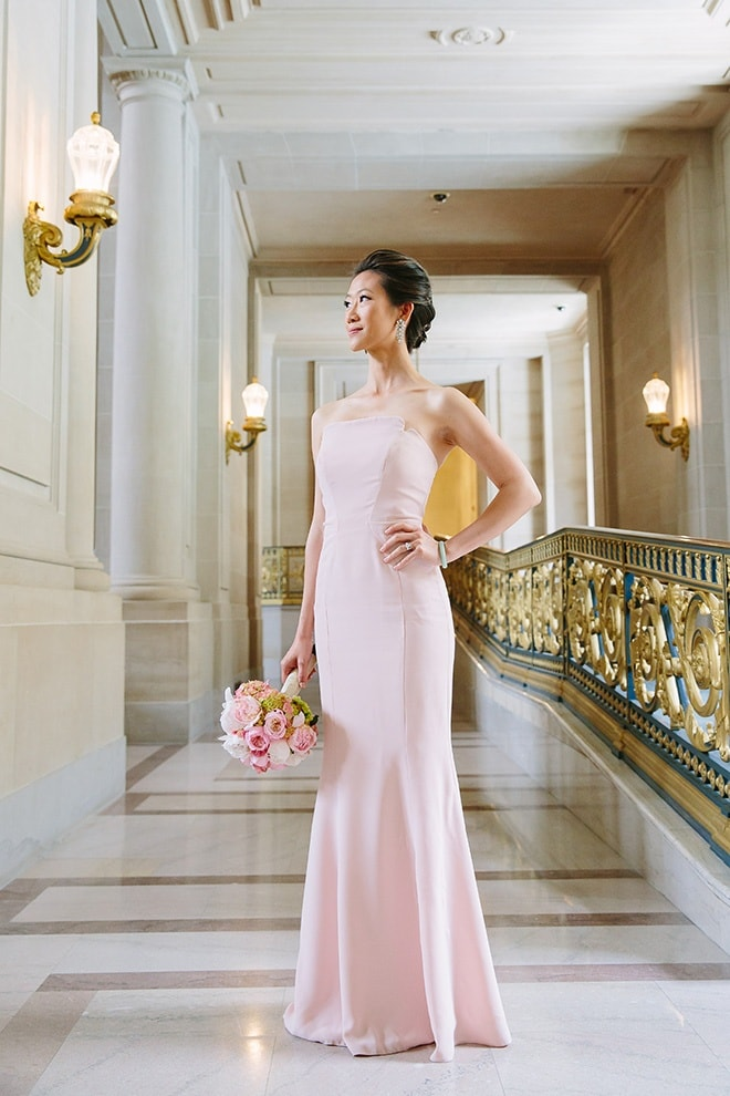 Bride wearing a pink wedding dress at her San Francisco City Hall wedding