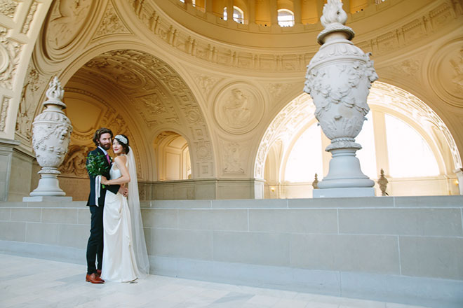 Bride and groom surrounded by beautiful architecture