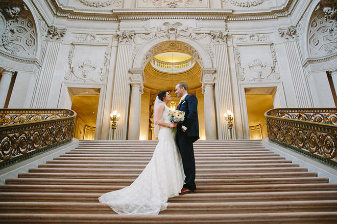Bride and groom standing on the Grand Staircase