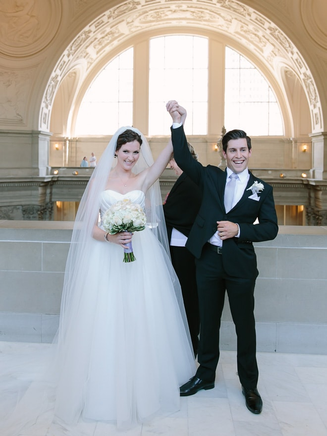 Bride and groom during their San Francisco City Hall wedding ceremony on the Fourth Floor North Gallery