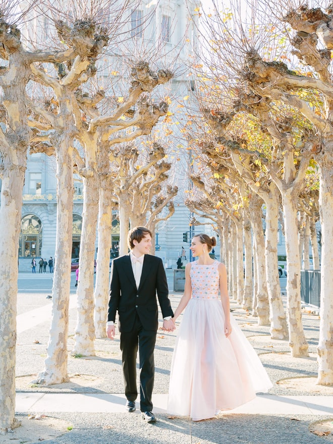 Bride and groom in front of San Francisco City Hall wedding