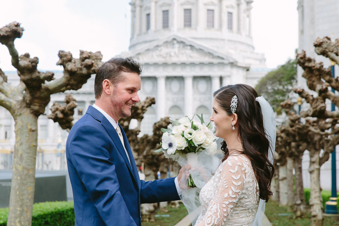 Groom sees his bride for the first time during a First Look in front of San Francisco City Hall