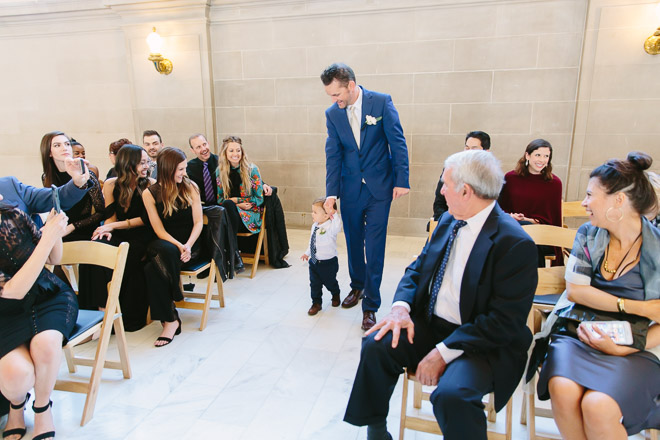 Groom walks down the aisle with his toddler son during a San Francisco City Hall wedding
