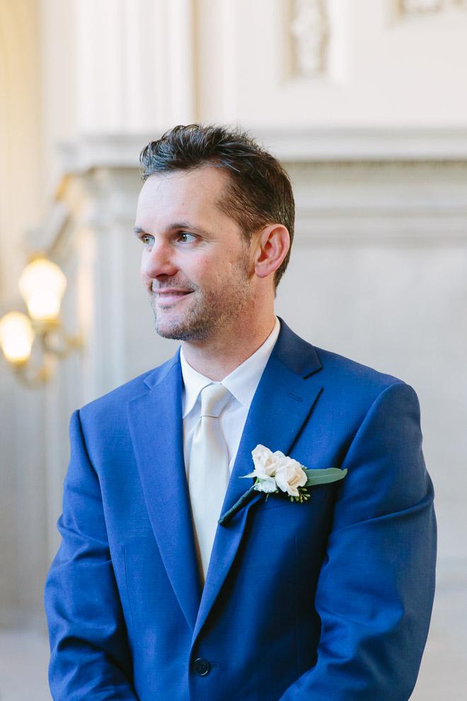Groom watching his bride