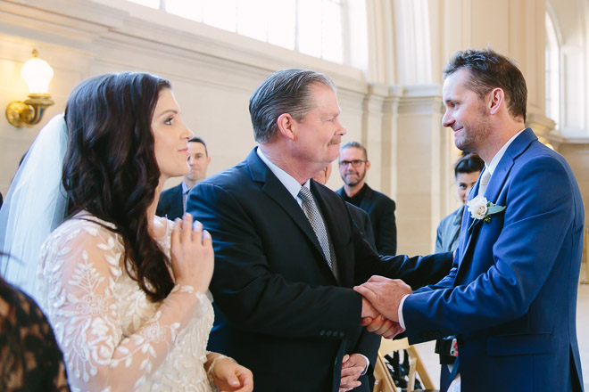 Groom shakes hands with the Father of the Bride