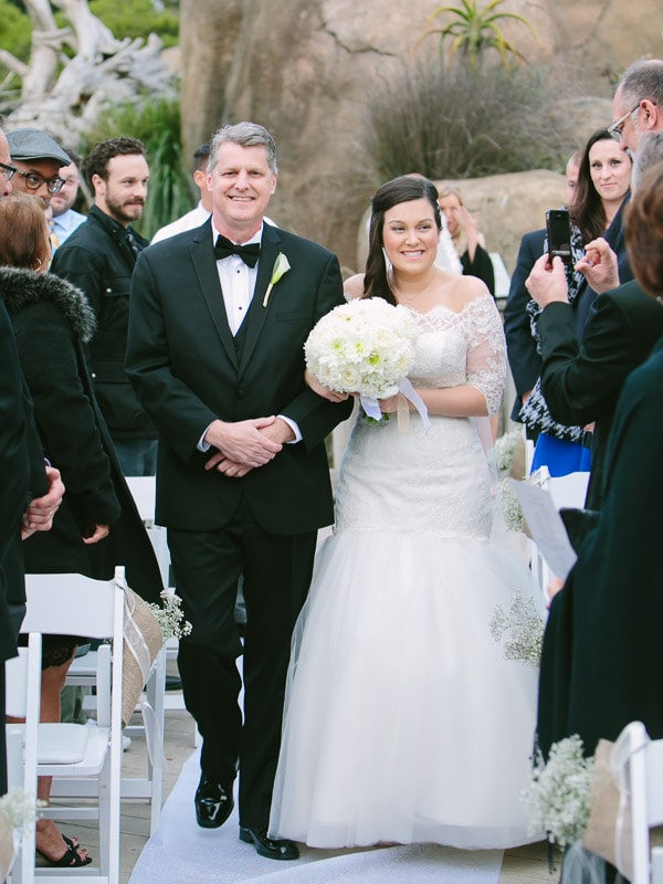 San Francisco Zoo wedding. Bride walking down the aisle with her father during her wedding ceremony.