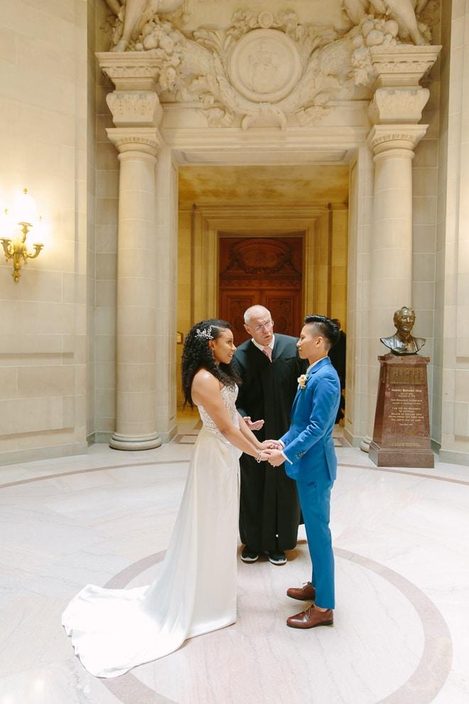Two brides getting married in the Rotunda of San Francisco City Hall. LGBTQ+ wedding