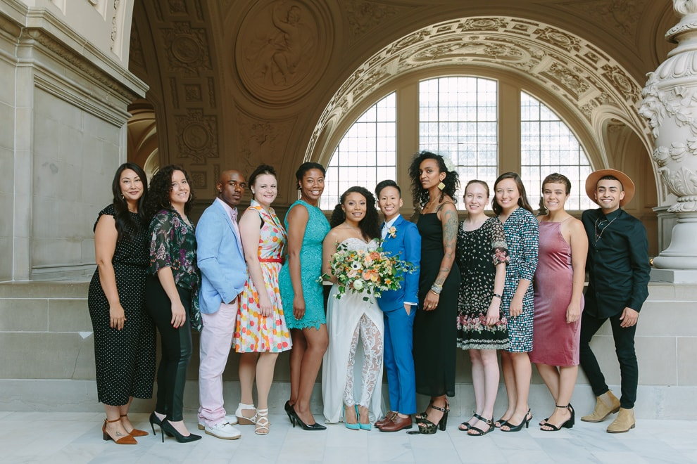 Recently married couple standing with their guests during their San Francisco City Hall wedding