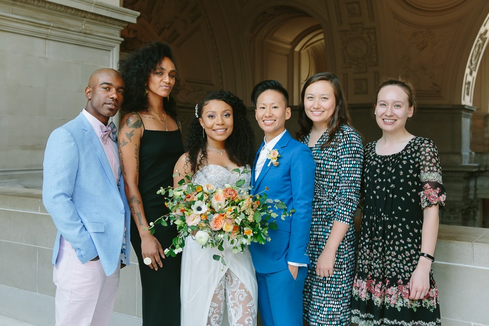 Recently married couple standing with their immediate family during their San Francisco City Hall wedding