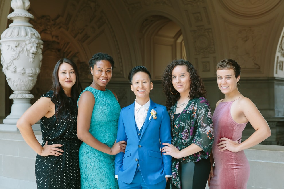 Bride standing with her friends after her wedding at San Francisco City Hall