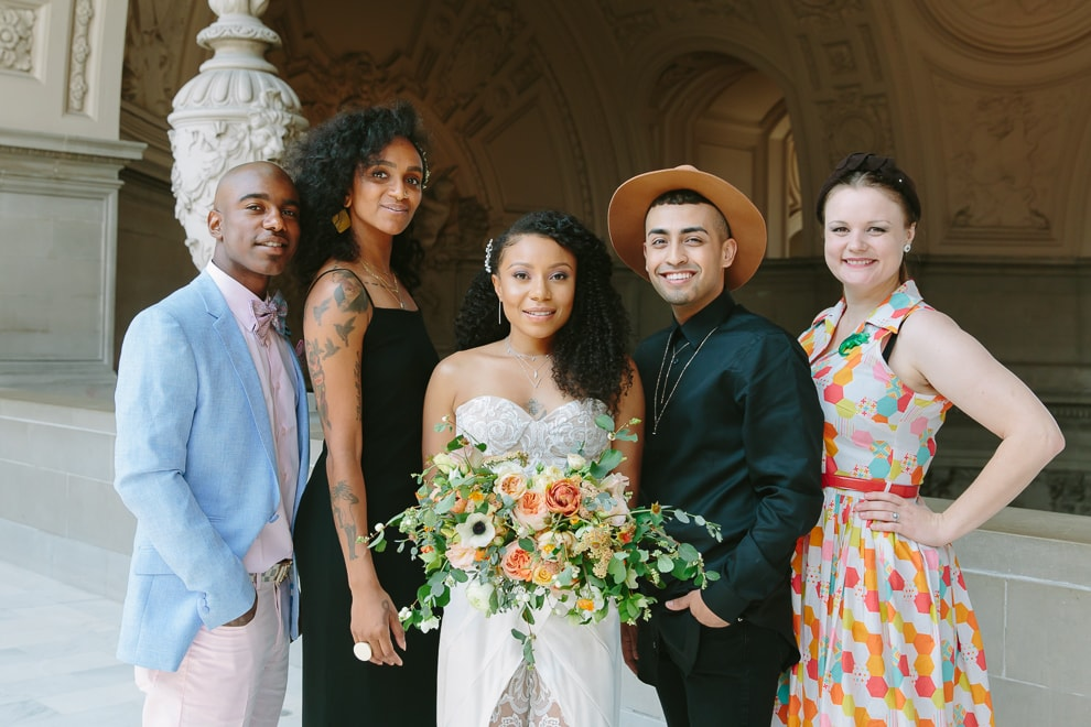 Bride standing with her friends and family after her wedding at San Francisco City Hall