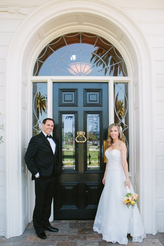 Bride and groom standing in front of a black door at their Silverado Resort Napa Wedding photographer
