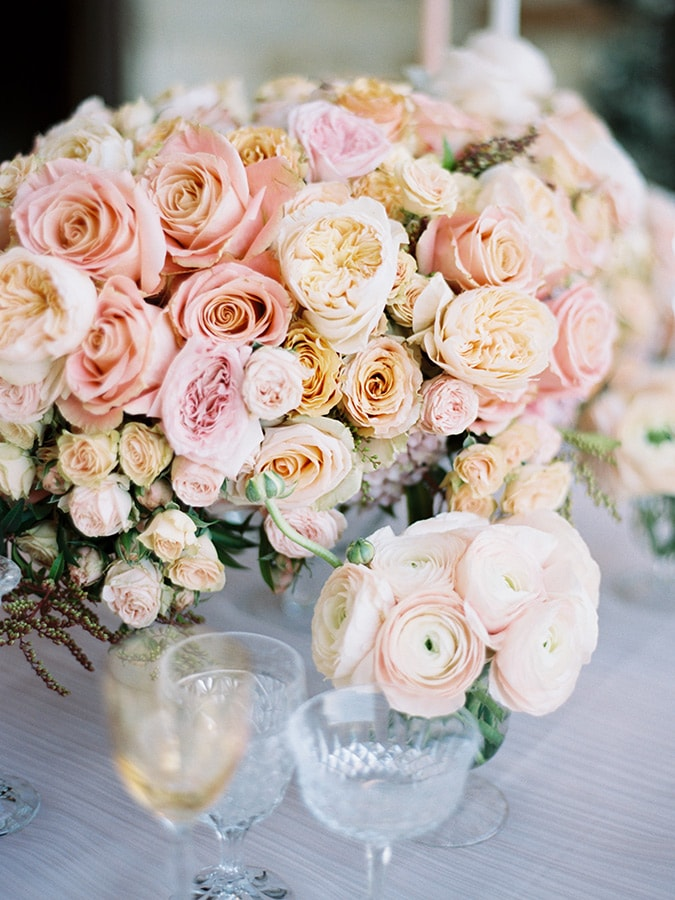 Beautiful pink roses on a wedding tablescape at Sunstone Winery in Santa Ynez California