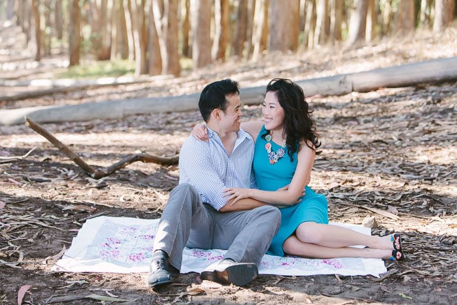 Presidio Woodline San Francisco engagement session. Couple sitting on a blanket together.